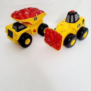 2 CAT toy trucks with lights and sound